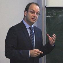 male teacher in front of blackboard